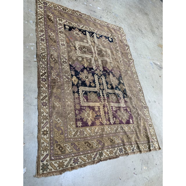 This is a wonderful antique / vintage caucasian rug. This rug is turn of the century and is hand woven wool with vegetable...