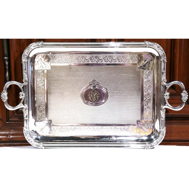 This elegant antique silver plated tray was created in Paris, France, circa 1894. The piece has two side handles, repousse...