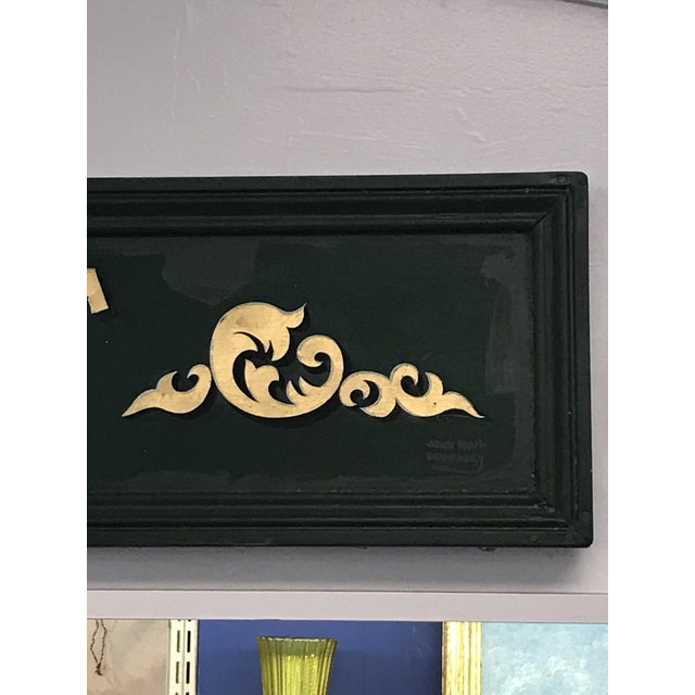 "Lavish forest green painted wood sign with gold painted ""NORTHLIGHT"" and accent motifs. Signed John Paul Gemeasky...."