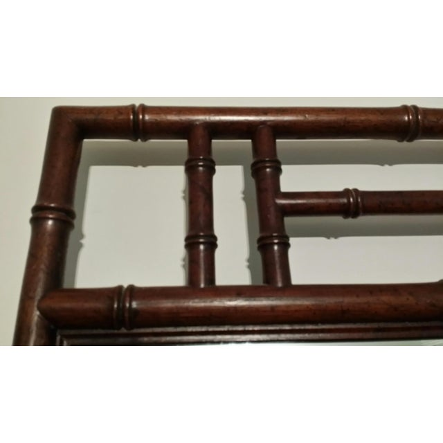 This is a Henredon bamboo style wall mirror that I bought with my Captain's Chest Collection and is in perfect condition....