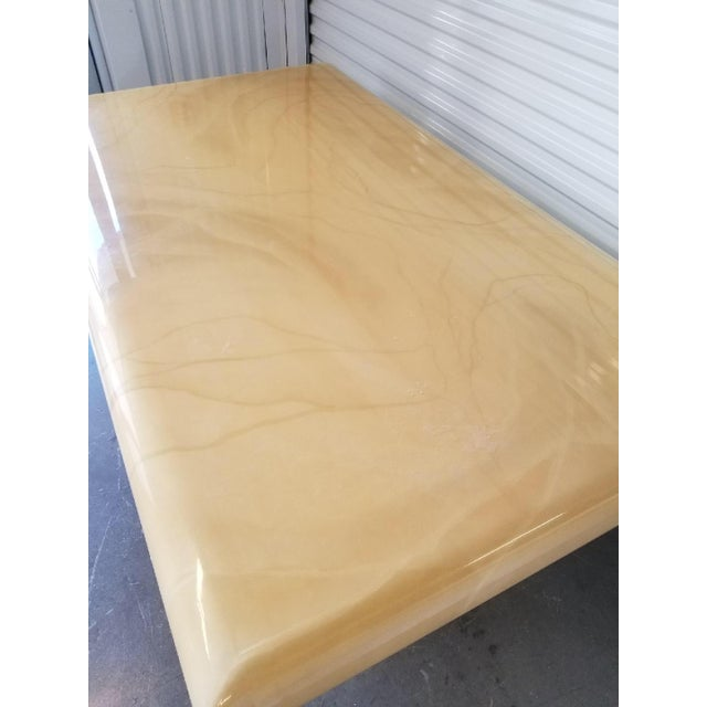 Stunning faux goat skin table! Can be used as a dining table or large desk. Has a beautiful butter scotch color.