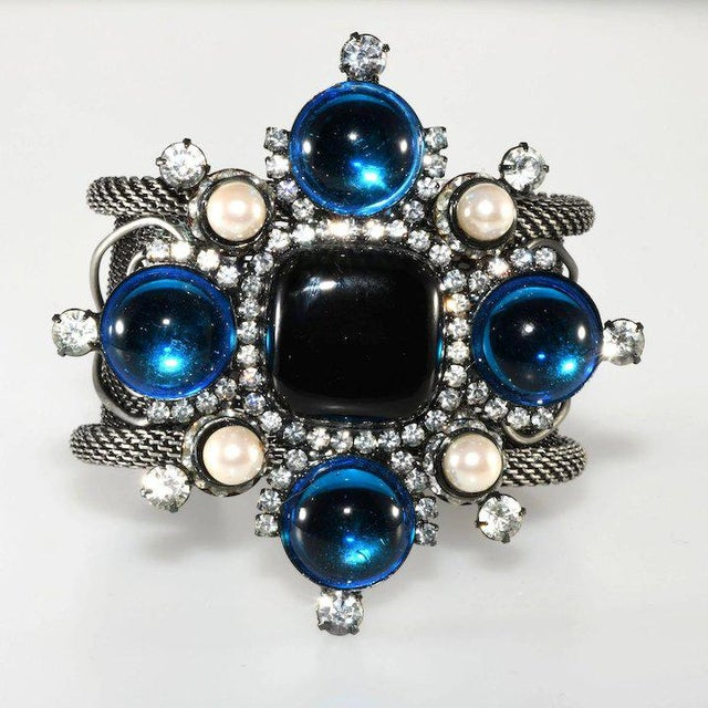 Amazing Maltese cross cuff statement bracelet with a central black opaque stones, bright blue cabochons, clear rhinestones...