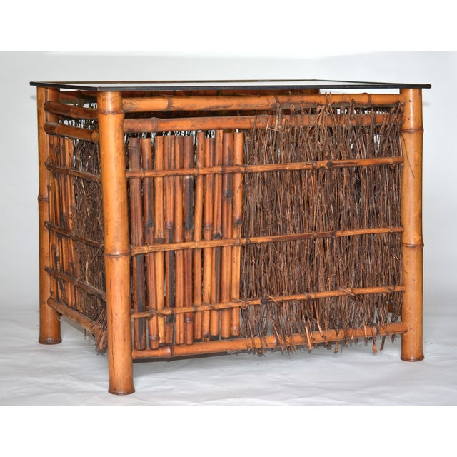 A wonderfully beautiful antique bamboo umbrella stand from Japan turned into a table with antique amber glass and copper...