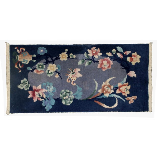 This is a handmade antique Art Deco Chinese rug in original condition. The rug is made in a night blue shade for the...