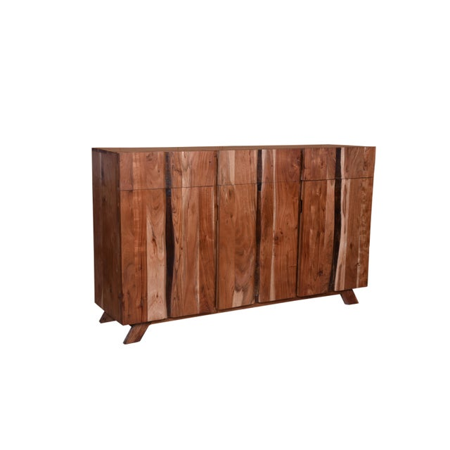 Three natural acacia wood doors-unique & functional are easy to open and reveals a vast storage area. Sideboard consists...