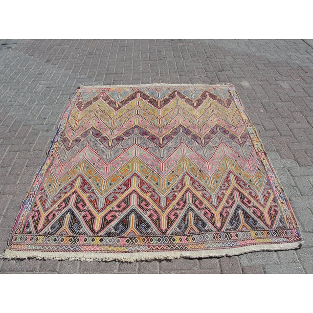 Offered is a vintage handwoven Turkish kilim rug. The kilim is nearly 45 years old. It is handmade of very fine quality...