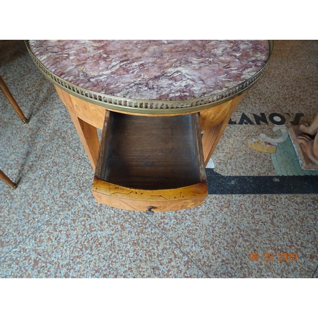 Fabulous late 19th century French bouillotte table with a marble top (yellow and dark pink colors) framed with a brass...