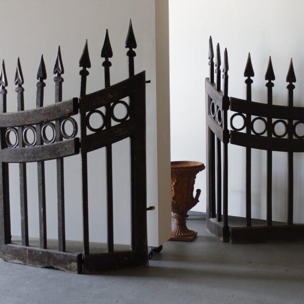 Pair of wooden stable gates with carved details. Height: 54″ Width: 39″ Depth: 2″