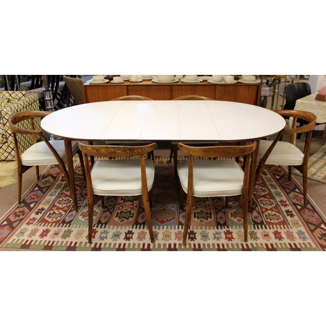 For your consideration is a classically luxe dining set, including table with three leaves and six side chairs, designed...