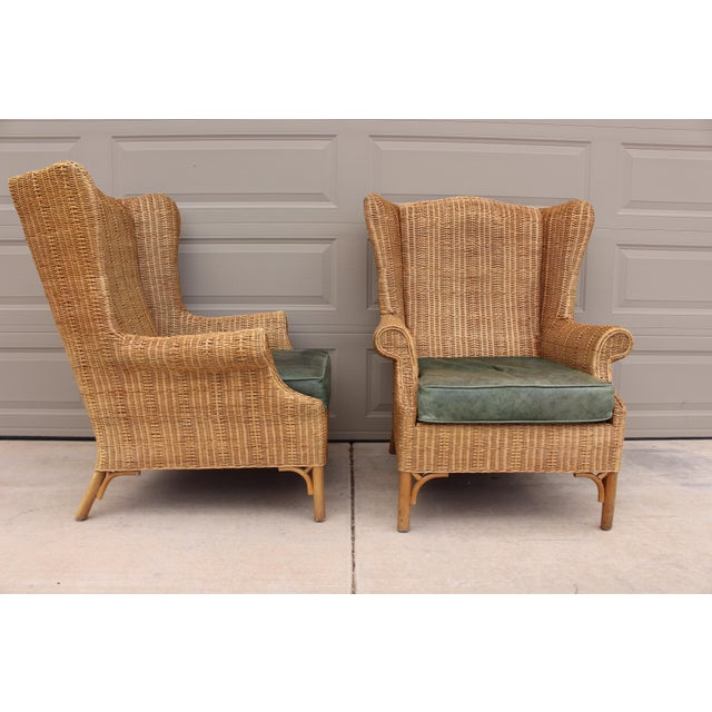 A pair of Vintage Henry Link for Lexington woven wicker wingback chairs with original green leather cushions made by...