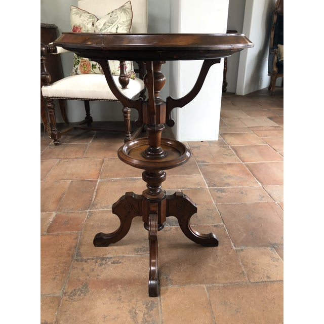 This warm and inviting chess table can be used as an accent piece or side table in any room. It has a beautiful dark...