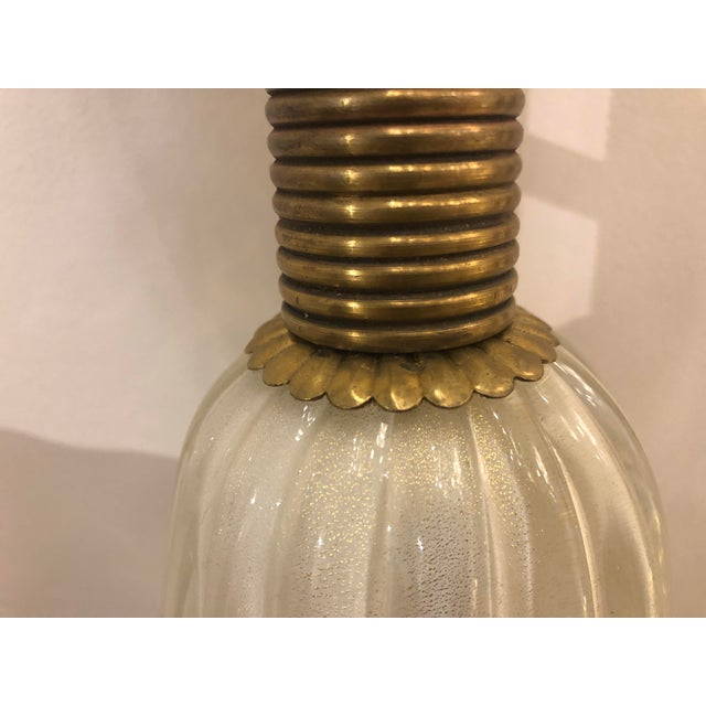 A pair of Barovier & Toso mid-century wall sconces. Feature Murano glass, fluting, and bell shape, with brass accents....