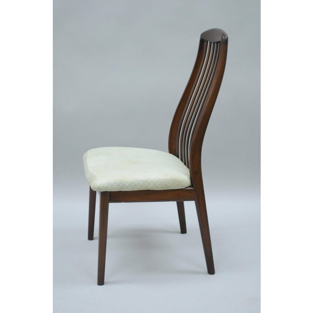 Item: Vintage Teak Wood Dining Side Chair by Dyrlund Details: Dark wood finish, Solid wood construction, Upholstered seat,...