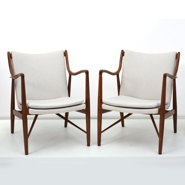 Matched pair of Finn Juhl Armchairs, Model FJ45 Denmark 1945 / USA ca. 1950s Sculpted walnut, wool, leather 33 h x 25 w x...