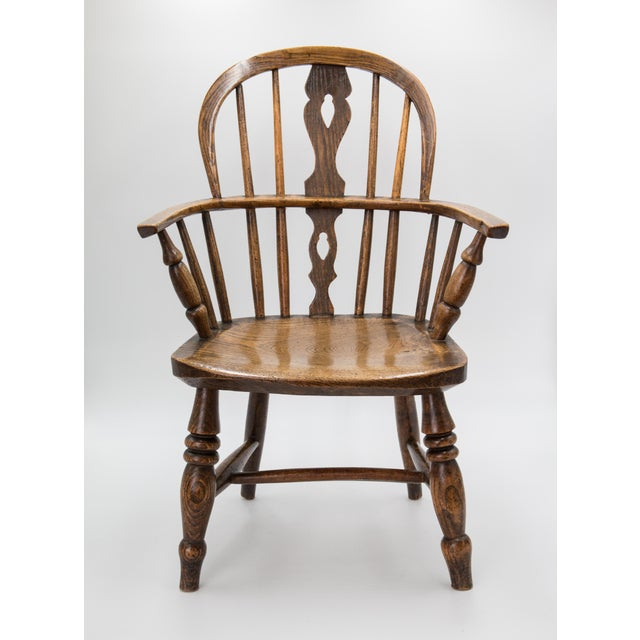 A superb early to mid 19th-Century English oak child's size Windsor arm chair. This fine quality chair is solid and sturdy...