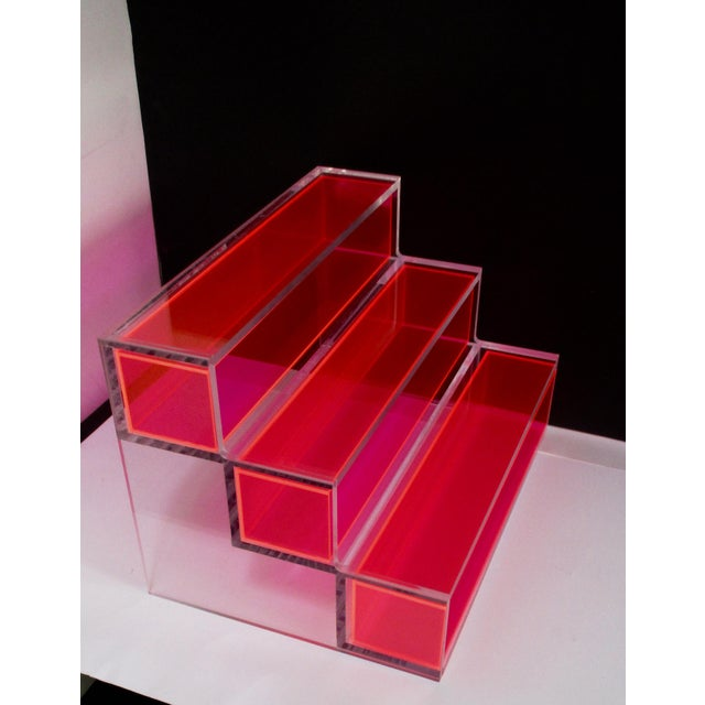 This thick block lucite display features Three tiers. A great piece for a mantel, book shelf, or console table. Use it to...