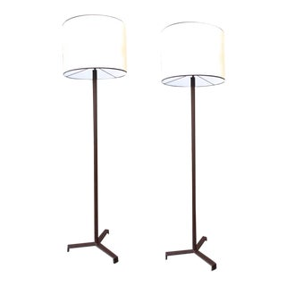 Jacques Adnet Burgundy Hand-Stitched Leather Pair of Standing Lamps Tripod Base For Sale