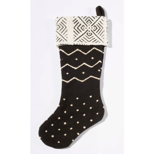 Beautiful Vintage Mudcloth Christmas Stocking. Black Mudcloth on the body and ivory on the cuff. There are 10 available....