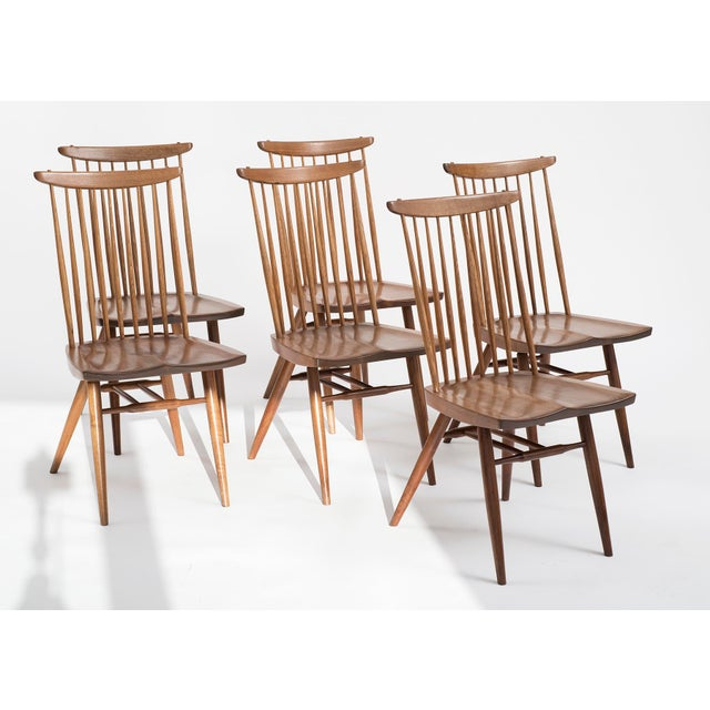 Six Nakashima new chairs in walnut and hickory. From the estate of noted architect Joseph St. Cyr of Sanibel Island...