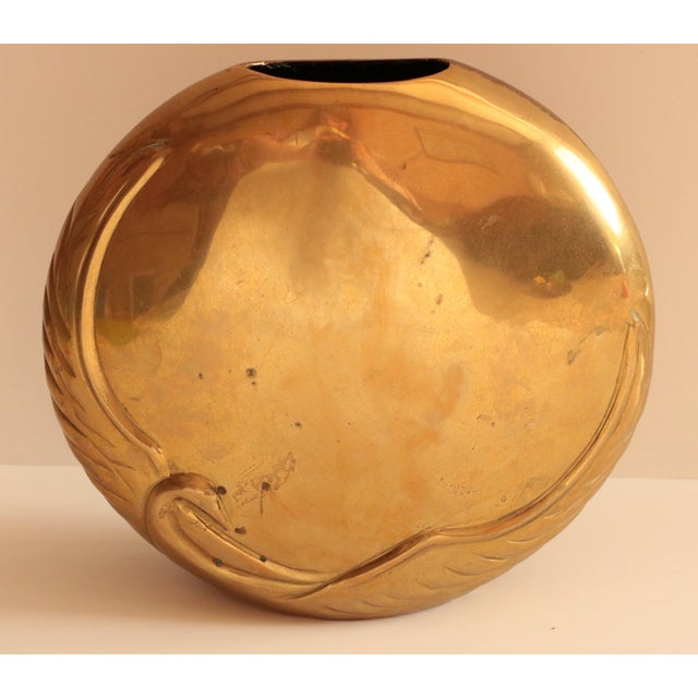 Vintage disc-shaped brass vase from Dara International, dated 1983. Classic, Art Deco styling; this heavyweight vase is...