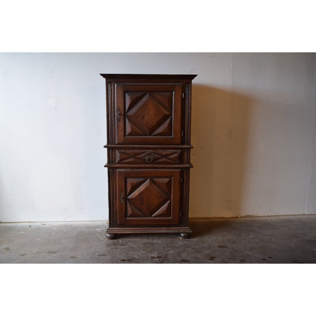 Beautiful 17th century French armoire, walnut. Deep diamond geometric patterns on each panel, as well as the center...