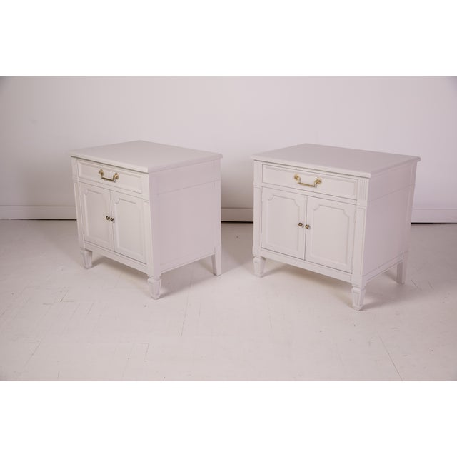 A pair of 1960s-era Madcap Cottage nightstands by Baker Furniture. Each has been newly refinished with a coat of grey...
