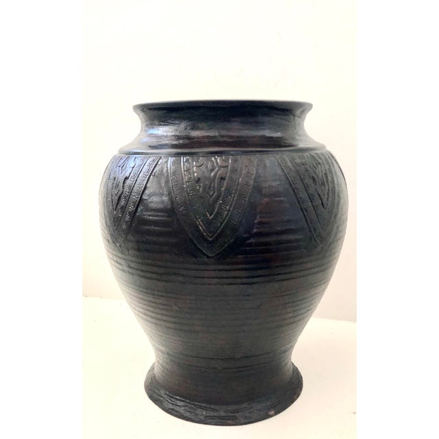An antique, heavy bronze vase from Kyoto Japan. Used for Ikebana or flower arrangements in a Buddhist temple. An...