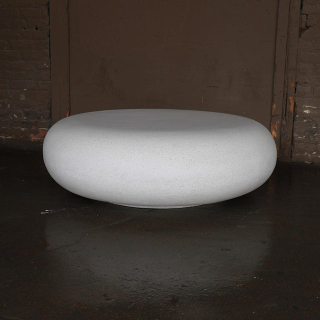 The pebble table is an elegant cocktail table with an organic form. Pictured in our white stone finish, the texture and...