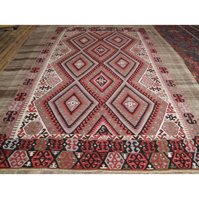 Lovely Turkish kilim with an unusual color palette and great tribal design.
