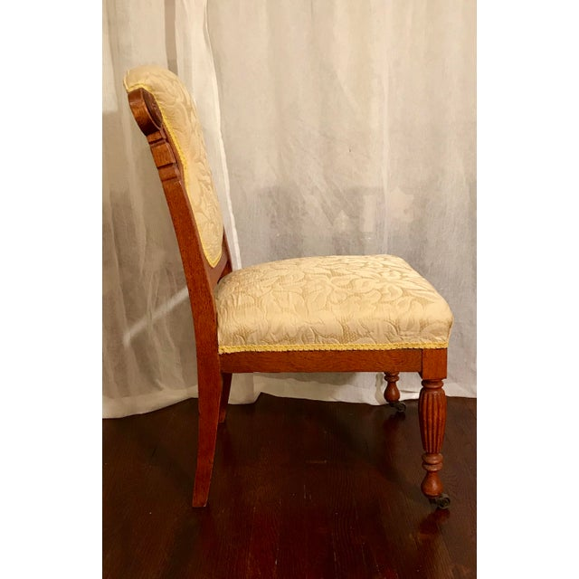 Uniquely carved, antique, Victorian era accent chair in the style of Charles Lock Eastlake. Featuring original antique...