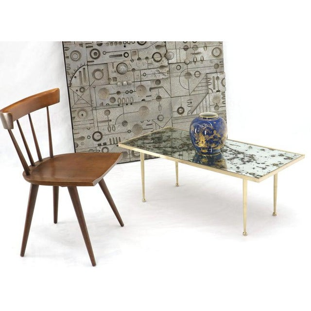 Mid-Century Modern spotted smoked mirror top rectangular Mid-Century Modern coffee table. Gio Ponti style tepered legs...