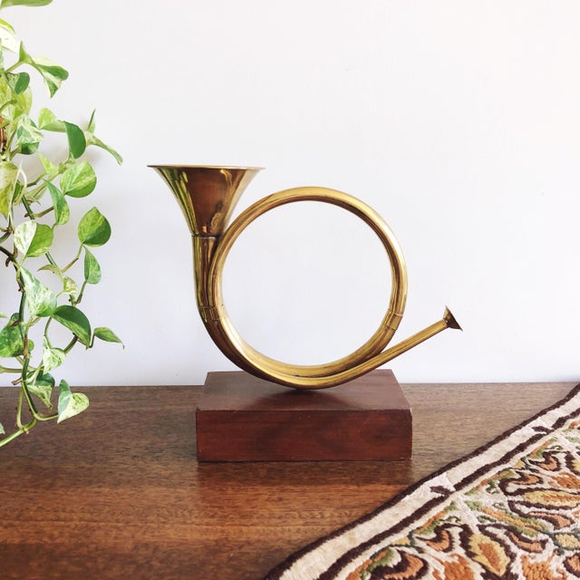 Vintage brass horn mounted on a wooden base. Lovely mid-century decorative object / bookend.
