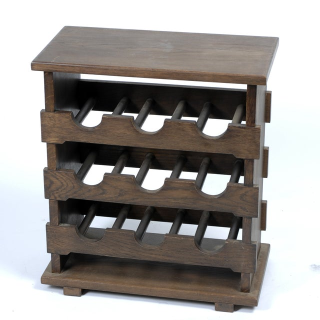 This handy vintage wine stand does double duty and acts a side table as well! Holds 9 bottles. Midcentury and made of...
