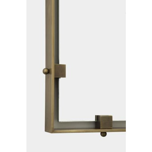 The Dylan rectangular wall mirror is hand crafted by local artisans in solid brass and features a floating frame with...