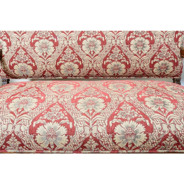 C.1870. Large red and tan upholstered settee. Lovely carved oak arm details.