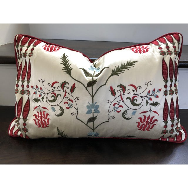 Custom designed kidney pillows made of Pierre Frey fabric. Embroidered on silk satin with silk cording, depicting the...
