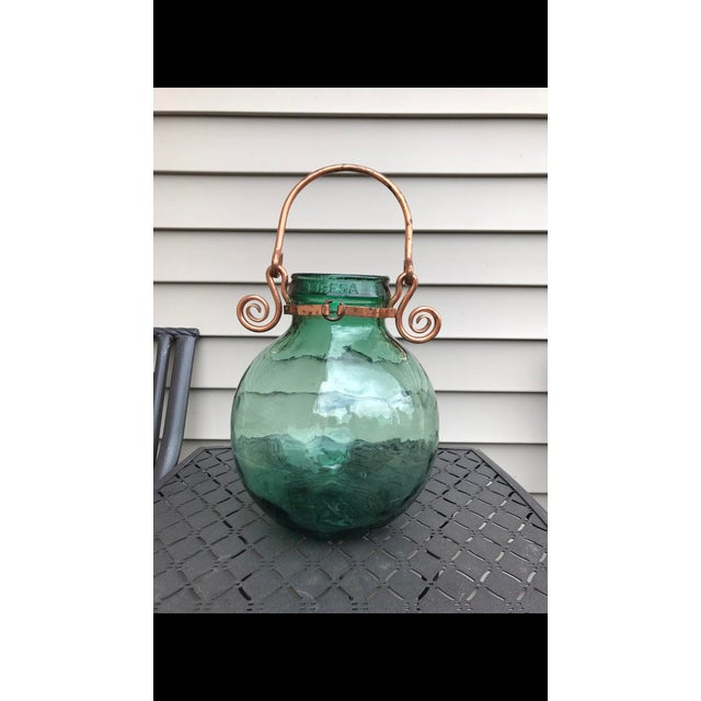 A beautiful green glass Carboy by Viresa . I've never seen with this handle and seems to be a one off . Great condition...