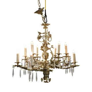 Quality Vintage Rococo Style Brass 12 Light Chandelier With Prisms For Sale