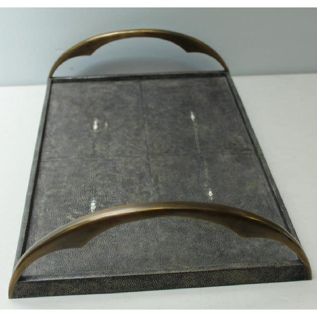 An elegant shagreen stingray serving tray with Bronze handles. By R & Y Augousti. Filipino, circa 1980.