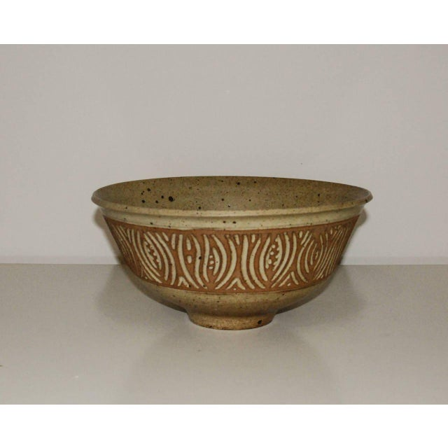 Circa 1990 A fine and large sgraffito stoneware bowl by master potter Peter Lane with a matte glaze. Lane has exhibited...