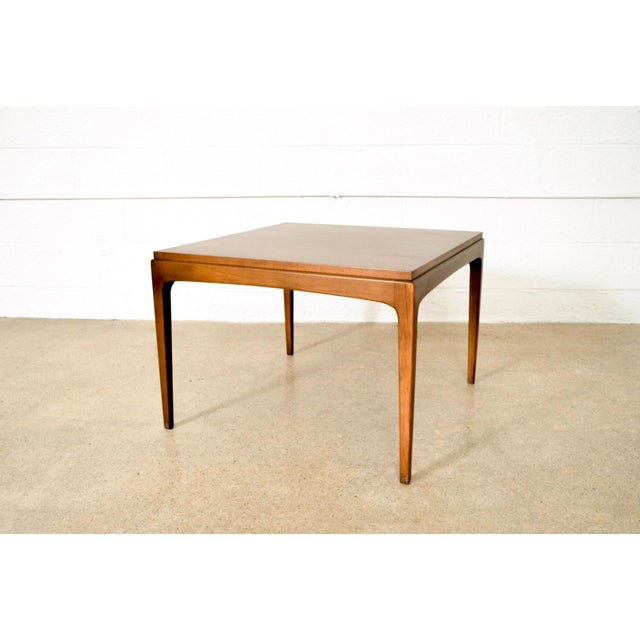 NOTE: Two matching rectangular tables also available separately. This vintage mid century modern Lane coffee table is from...