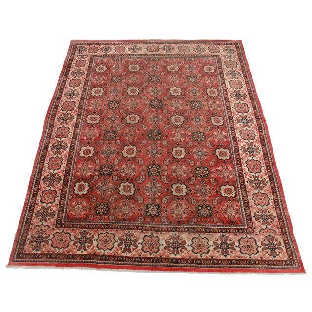This is a vintage hand knotted wool Persian Mahal rug with an all-over medallion design.
