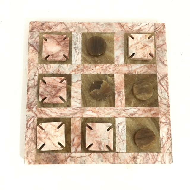 Stunning tic tac toe game board carved out of pink and dark tan marbled stone. Complete set includes board, 5 x's and 4...