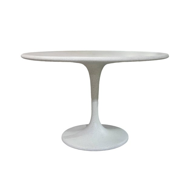 The Spindle Dining table is iconic. The texture and modern look of concrete make it appropriate for a wide variety of...