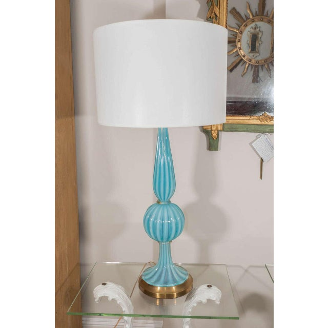 """A striking lamp in fluted Murano """"Tiffany"""" blue glass on a brass base."""