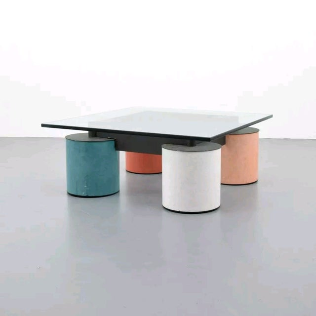 Modern and geometric coffee table by Massimo Vignelli. Circa 1979. Materiality: Glass, blackened steel, enamel paint...