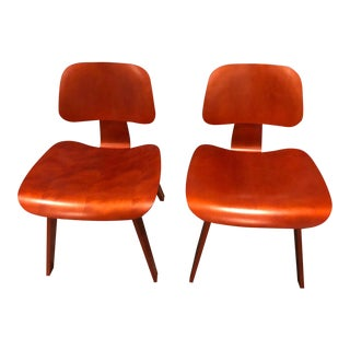 Eames Red Molded Plywood Lounge Chairs - a Pair For Sale