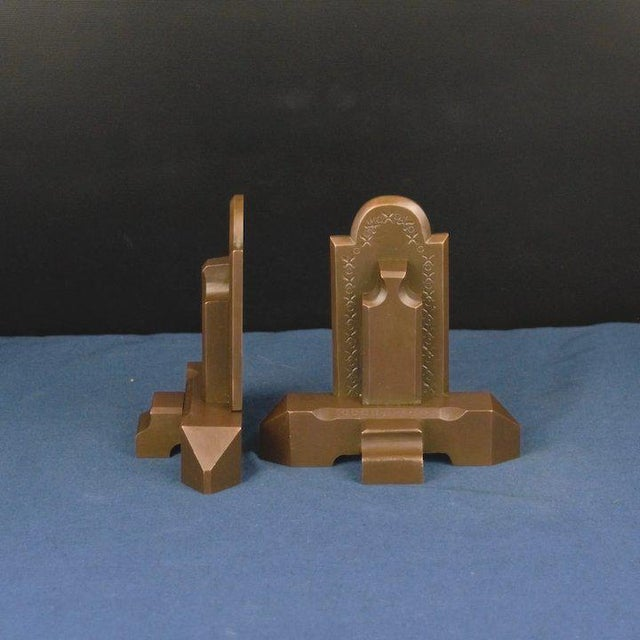 These bronze bookends are a great example of period craftsman quality. They are put together by means of a dovetail joint....