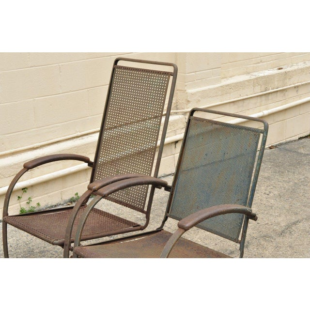 Steel metal perforated backs & seats which is slightly different between chairs, heavy steel construction, authentic...