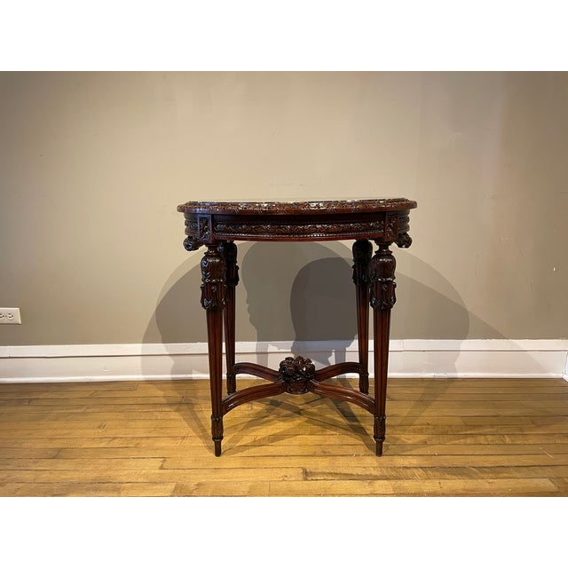 Beautiful French antique solid walnut side table with four carved column legs intersected with an x cross featuring...
